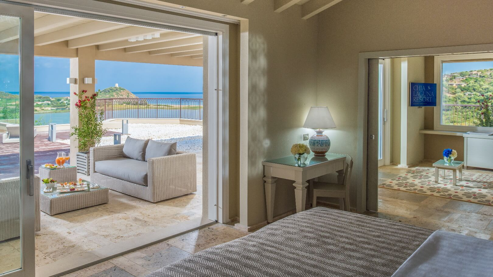 https://www.chialagunaresort.com/wp-content/uploads/2021/04/IHC_Chia-Laguna-Resort_grid_CL4U_terrace-suite.jpg