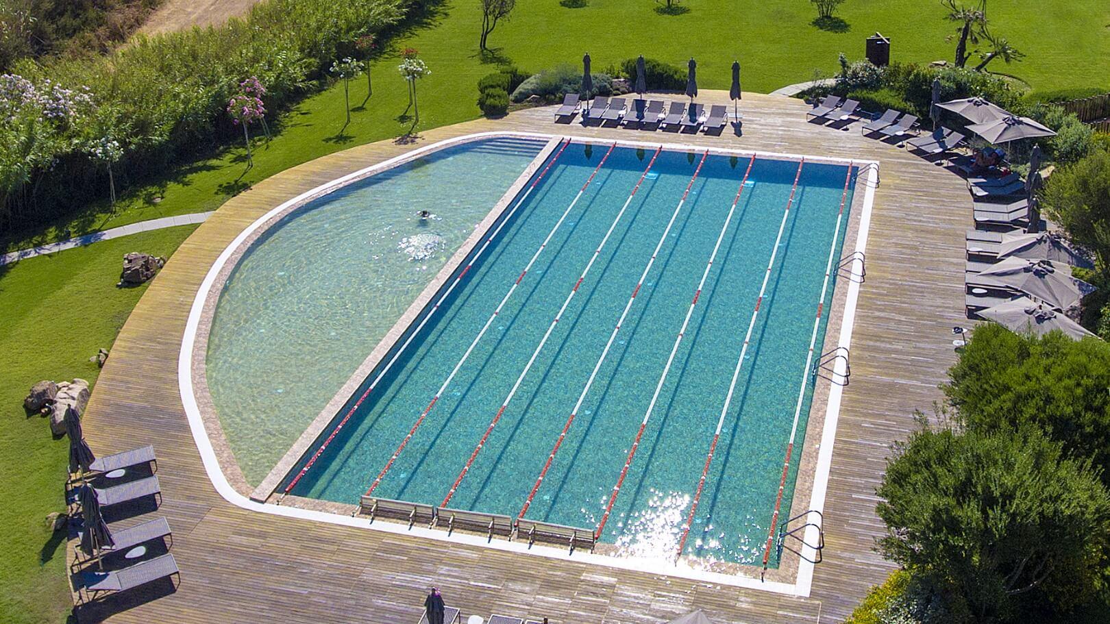 https://www.chialagunaresort.com/wp-content/uploads/2021/05/IHC_Chia-Laguna-Resort_grid_CL4U_pool.jpg