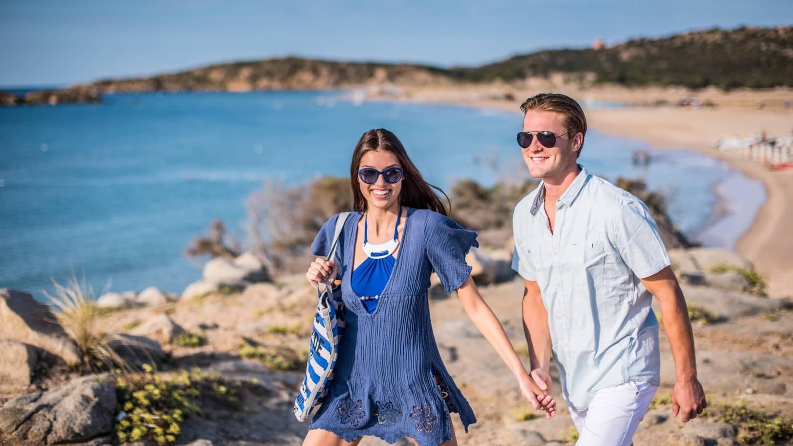 https://www.chialagunaresort.com/wp-content/uploads/2021/05/IHC_Chia-Laguna-Resort_grid_romantic_couple-beach-walking.jpg
